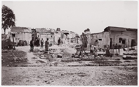 [Encampment with shacks and laundry].  Brady album, p. 129