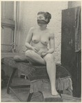 Nude Female Model With Scarf Over Mouth