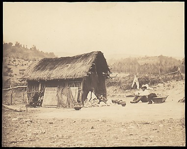 [Family Seated by Thatched Hut, South America]