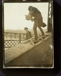 [Alfred Stieglitz Photographing on a Bridge]