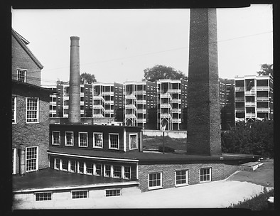 [Factory Buildings and Smokestacks in Front of Apartment Buildings, Windsor, Vermont]