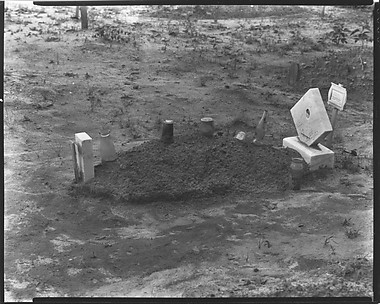 [Child's Grave with Bottles and Jars on Plot, Hale County, Alabama]