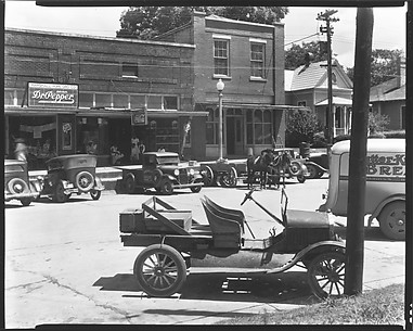 [Street Scene with Parked Cars, Mule-Drawn Wagon, and Bucket Seat Model T Ford, Marion, Alabama]