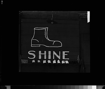 [Shoeshine Sign and Display on Wall]