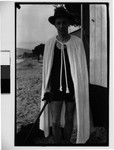 [Walker Evans in Hat and Cape Holding Cane]