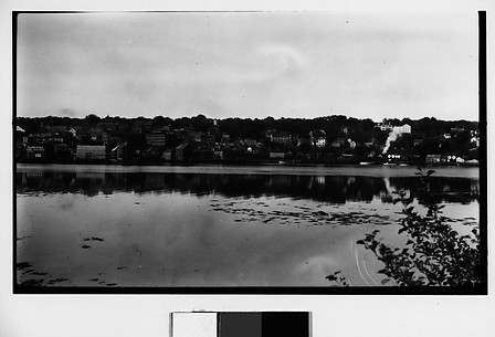 [Houses and Train on Railroad Track, Seen from Across River]