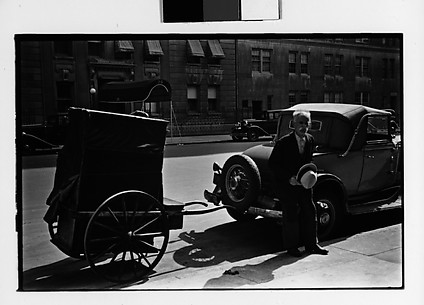 [Man and Covered Pull-Cart on Street, New York City]