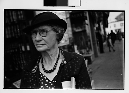 [Old Woman Outside Main Street Grocery Store, Ossining, New York]