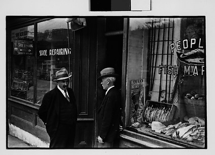 [Two Men in Conversation Outside Shoe Repair Shop, Ossining, New York]