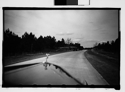 [People Walking by Road in Distance, From Moving Automobile, Macon, Georgia]