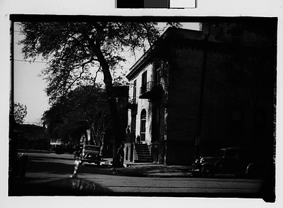 [Italianate Town House and Parked Cars on Corner, From Automobile, Savannah, Georgia]