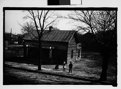 [Wooden House with Children in Yard, From Moving Train, Savannah, Georgia]