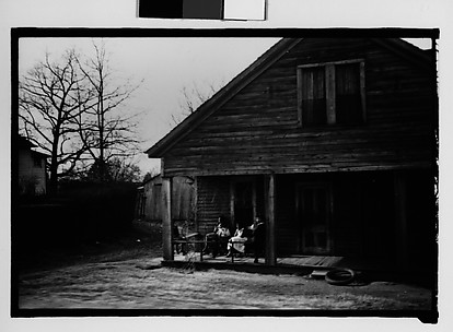 [Wooden House with Women Seated on Porch, From Car, Mobile, Alabama]