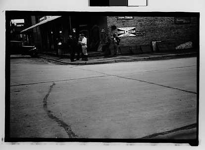 [Street Scene in Front of Builders Hardware Store, From Car, Mobile Vicinity, Alabama]