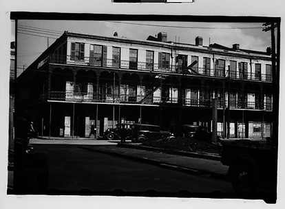 [Cast-Iron Balconied Houses with Parked Cars and Pedestrian on Street Corner, Mobile, Alabama]