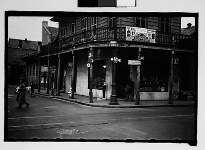 [Corner Grocery Store with Woman Crossing Street in French Quarter, New Orleans, Louisiana]