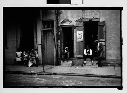 [People Seated on Stoops on Burgundy Street in French Quarter, New Orleans, Louisiana]