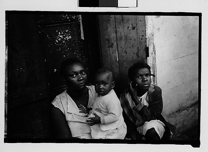 [Mother and Children Seated in French Quarter Doorway, New Orleans, Louisiana]