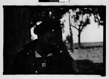 [Man Wearing Cap and Overalls Next to Tree, Hale County?, Alabama]