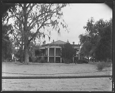 [Greek Revival (Plantation?) House with Wire Fence in Foreground]