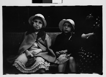 [Subway Passengers, New York City: Two Little Girls in Bonnets Seated Next to Woman in Polkadot Dress]
