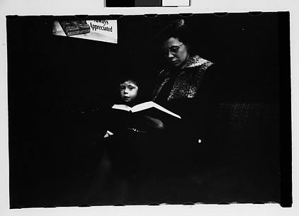 [Subway Passengers, New York City: Mother with Book on Lap and Child]