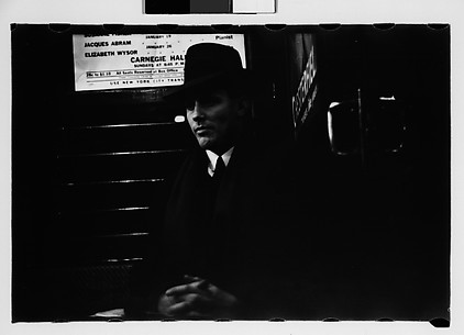 [Subway Passenger, New York City: Man Wearing Hat in Car Corner]