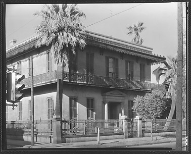 [Stone Town House with Cast-Iron Balconies and Fence in French Quarter, Esplanade Avenue, New Orleans, Louisiana]