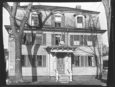[Greek Revival House with Figurehead Above Entry Porch]