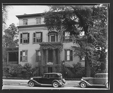 [Brick Greek Revival Building with Ivy-Covered Entry Porch and Parked Cars in Foreground, Funeral Home, Augusta, Georgia]