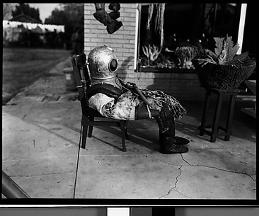 [Sponge Diver's Suit in Front of Mermaid Curio Shoppe, Florida]