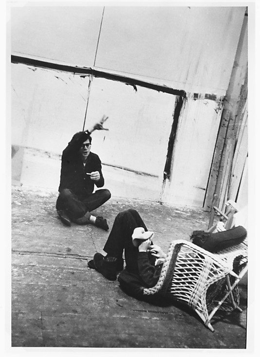 [Allen Ginsberg and Gregory Corso Seated on Floor in Conversation, During Filming of