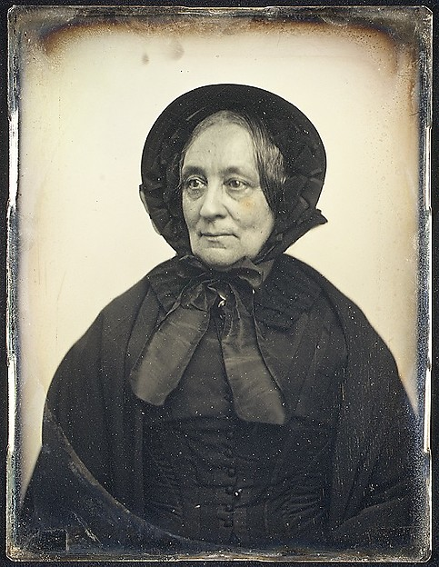 [Elderly Woman in Black Cape and Bonnet]