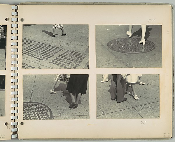[Legs of Woman Walking Across Manhole Cover, New York City]