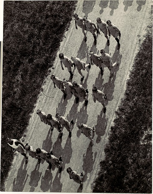 [Boys Marching on a Road, from Above]