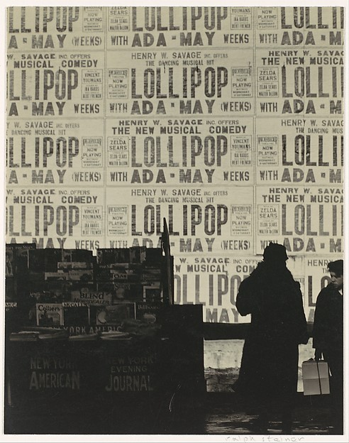 """[Newsstand and Figures before Theater Posters Advertising the Musical """"Lollipop""""]"""