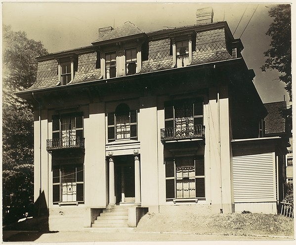 [Victorian Architecture: House with Fluted Columns and Mansard Roof]