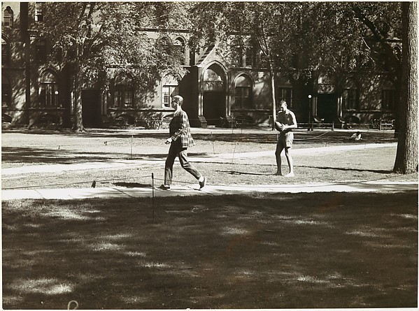"[Young Man on Footpath and Shirtless Student Holding Football in Yard, Yale University Campus, New Haven, Connecticut, Possibly for Unpublished Fortune Portfolio ""The Clothes""]"