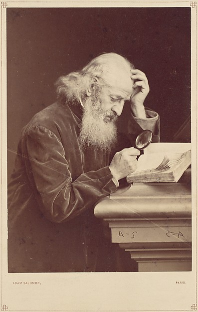 [Bearded Man with Magnifying Glass Examining a Manuscript]