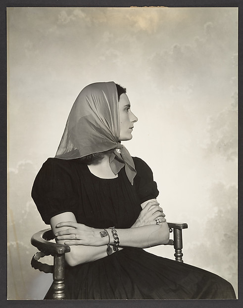 [Woman in Scarf Seated in Chair]