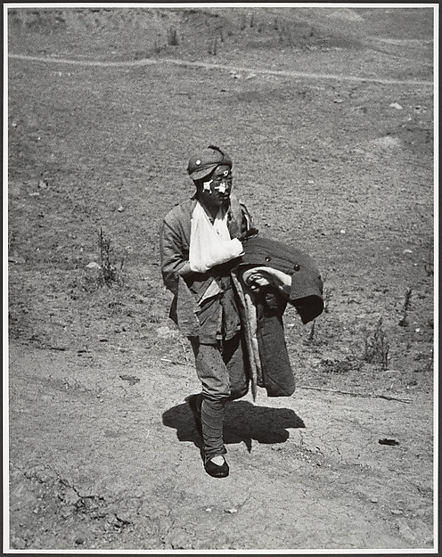 A wounded soldier treks six miles to a hospital behind the front lines after the Chinese victory at Taierhchwang, April