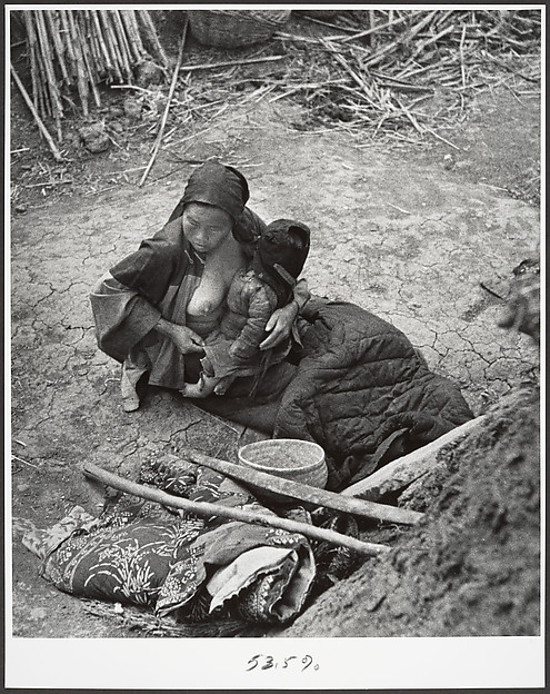 After the bombardments, this mother is one of many who keep alive by eating herbs and roots, Taiherhchwang