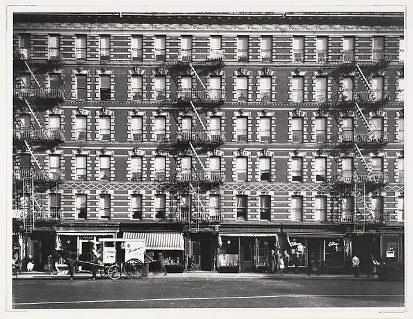 [Apartment Building Façade with Horse-Drawn Carriage, Sixth Avenue, New York]