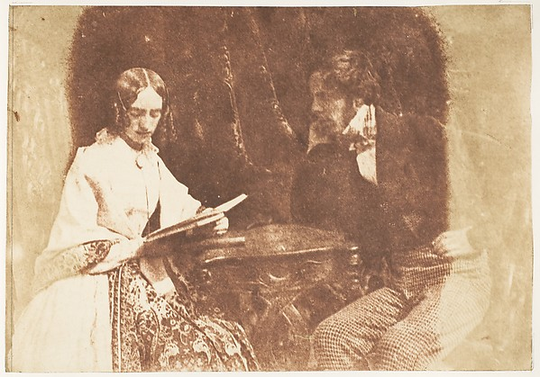 Couple Seated, Woman Reading