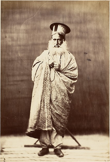 [Eastern Man with White Beard, Standing]