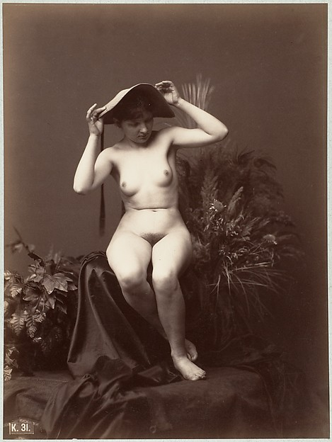 [Nude Woman with Hat in Studio]