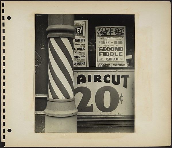 [Barber Shop Facade Detail with Pole in Foreground and Movie House Posters in Window, New York City]