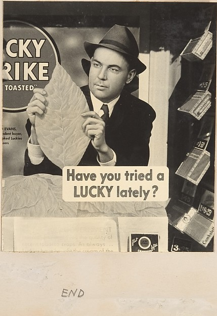 [Cigar Store Window Advertisement for Lucky Strike Cigarettes Showing Man Holding Tobacco Leaf, New York City]