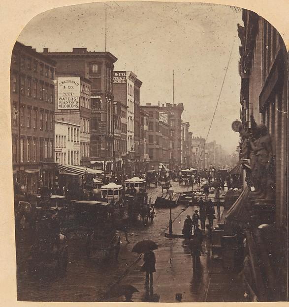 [Broadway, New York City, in the rain]