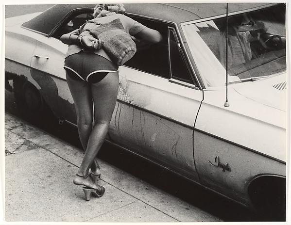 [Street Scene: Woman in Shorts Leaning into Window of Parked Car, New York City]